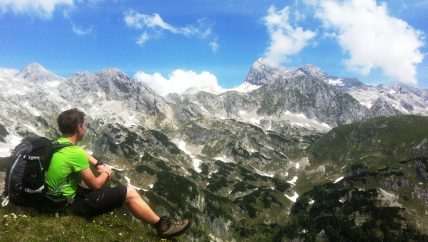 hiker resting and mt. Triglav