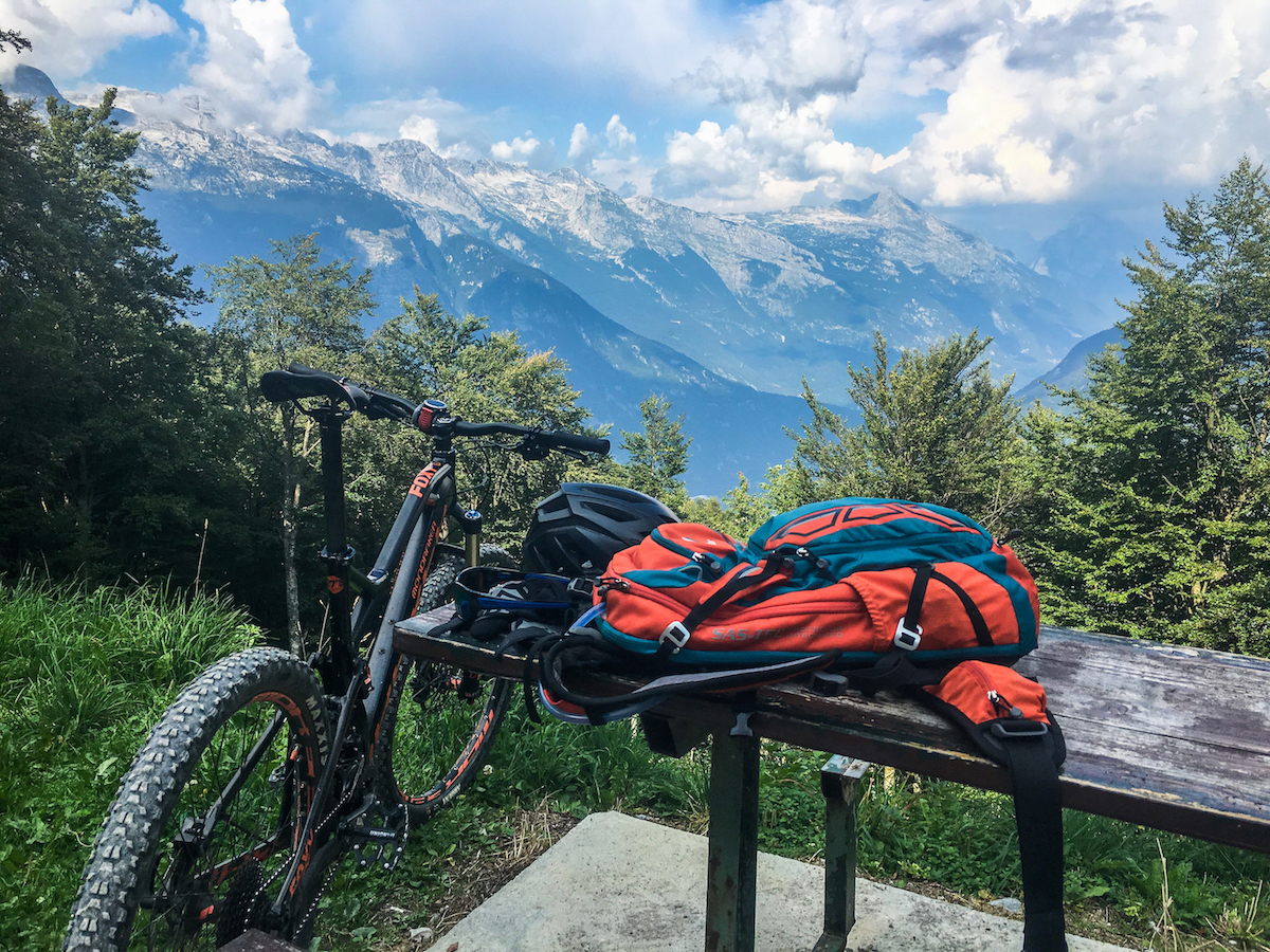 bike and backpack above the julian alps