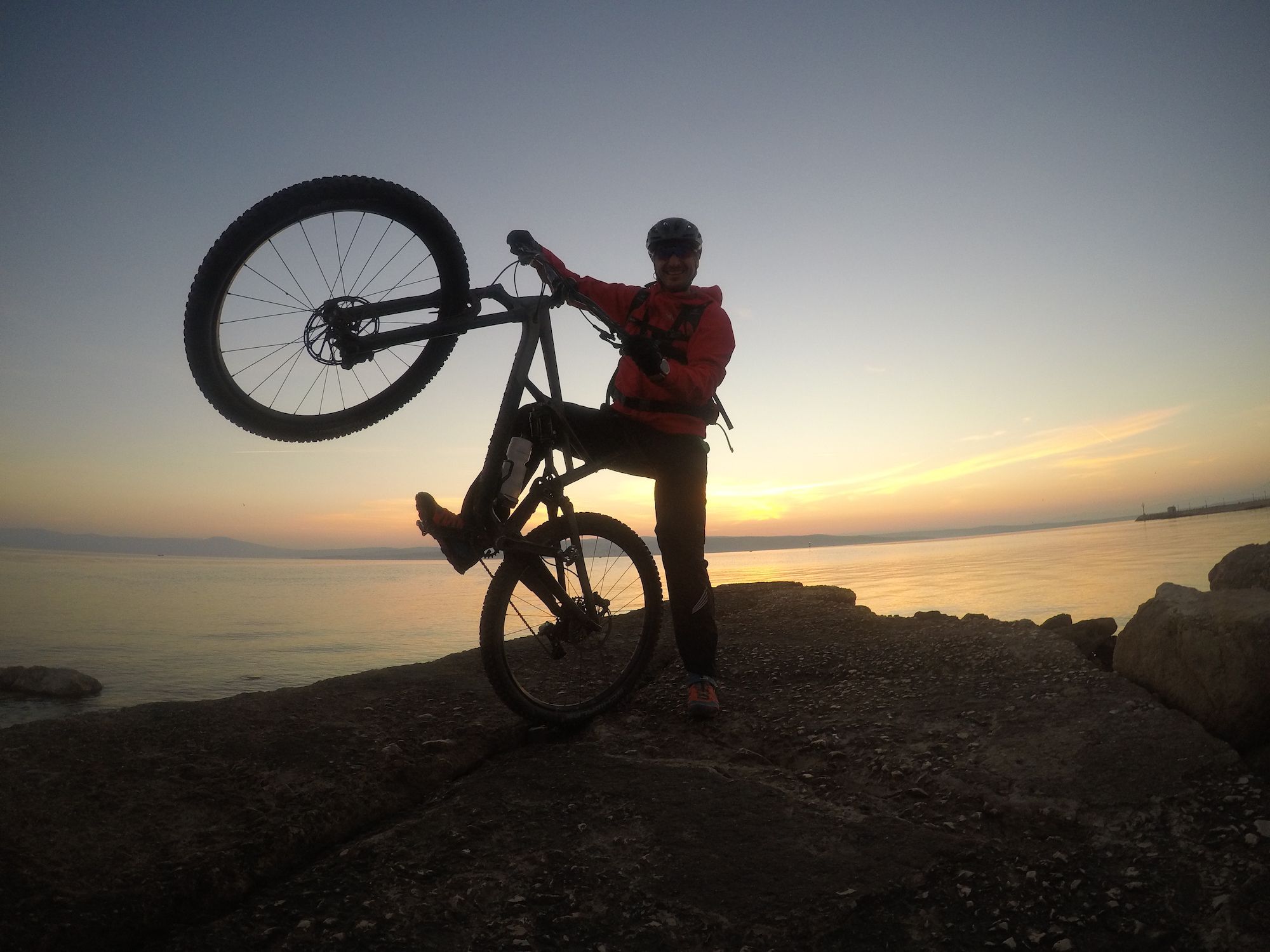 sunset with bike at adriatic sea