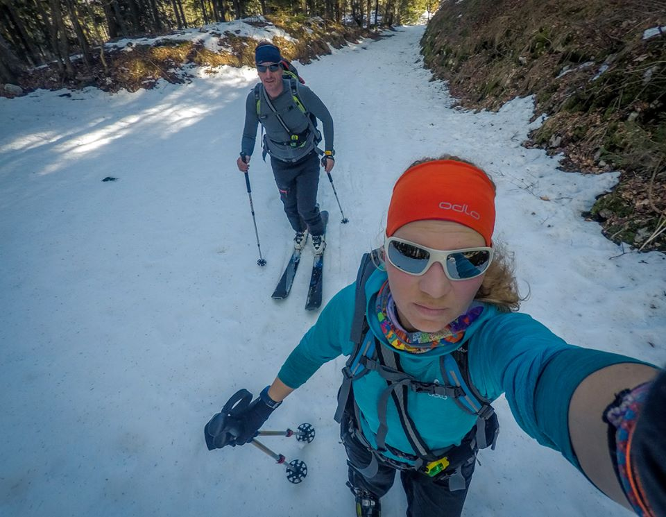 skitouring in bohinj valley going uphill