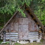 traditional wooden mountain hut in julian alps