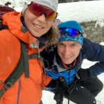 happy backcountry skiers in bohinj valley