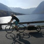 road cyclist with trailer by the bohinj lake