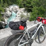 gravel bike on a bridge over the soca river