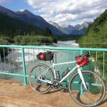 gravel bike on a bridge across soca river
