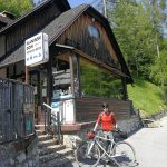 gravel biker by the mountain hut